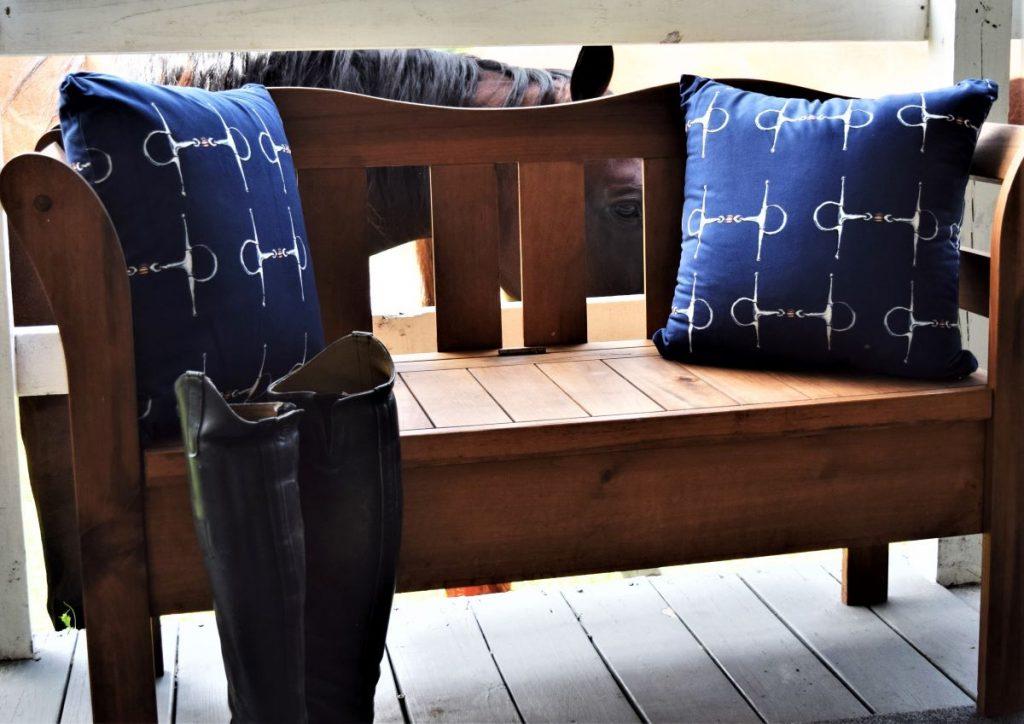 blue throw pillow horse bit pattern