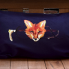 foxhunting lumbar pillow on blue