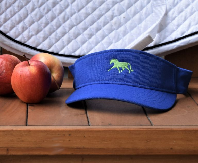Blue sun visor wirh green dressage horse and a couple of apples on a lovely bench